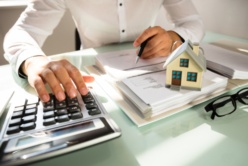 Person calculating the cost of a move to a new home